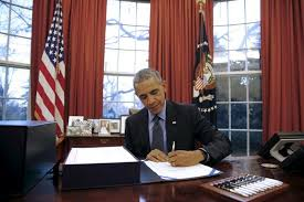 file us president barack obama signs the 11 trillion government funding bill into law at barack obama enters oval
