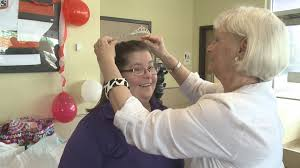 employee celebrates decades of hard work and caring for mcdonald s customer marita o neil maloley places a tiara on claire johnson on