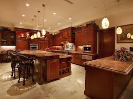 cooler kitchen peninsula photos rich red wood over beige marble flooring throughout this kitchen large