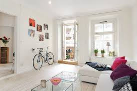 storage solutions living room:  bike storage ideas wall hanging cycle parking modern interior design living room decorating ideas