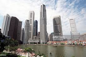 Trip and Tourism Essay   Essay Writing Singapore Blog Best Essay Writing Service in Singapore A view of the Singapore highrise buildings of the financial district of Raffles Place    August