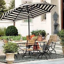 white striped patio umbrella: our auto tilt umbrella turns an outdoor table into a shaded outdoor haven the base is made of lightweight scratch resistant aluminum