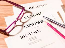 resume examples and writing tips pile of resumes glasses and pen
