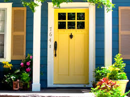 bright blue house wall painting paired with yellow front door color between french windows plus succulent bright colorful home