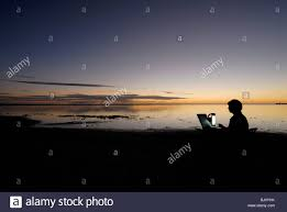 lance writer working in inspiring beach and sunset location lance writer working in inspiring beach and sunset location