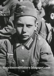 uncensored history dark chapters of history images of war you re allowed to capture children old hitler youth captured by us troops near martinzell the look in his eyes is far from what you see in hitler