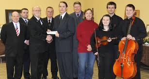 oswego community youth orchestra presented donation from lake city from left lodge brothers pat fasulo robert baldwin harry frazier ron bond