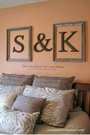 bedroom ideas couples: looking for a fresh update to your bedroom decor try framing initials in open frames like in this mini bedroom makeover finish with a vinyl quote below