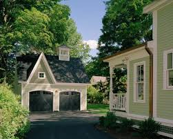 Carriage House Home Design Ideas  Pictures  Remodel and DecorThis is an example of a victorian green exterior in Other   a gable roof
