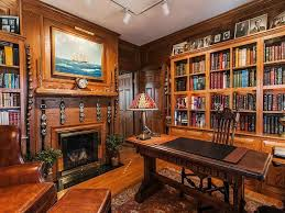 the nearly 4700 square foot home has many of its original appointments from hand wrought bronze arts crafts light fixtures to extensive woodwork arts crafts home office