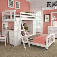 charming loft beds for teenagers in white with pink bedding and desk before the pink wall charming kids desk