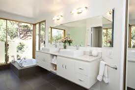 over bathroom cabinet lighting innovative strasser woodenworks in bathroom modern with beveled mirror next to soffit above mirror lighting bathrooms