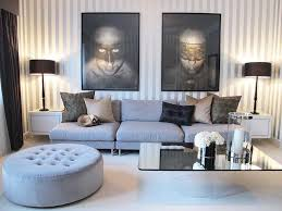 marvelous brown and black living room design and decoration using light brown living room wall paint including rectangular dark brown leather ottoman blue dark trendy living room