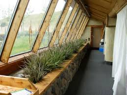 Tour  tire house where we lived   Making This HomeAre you ever faced   those love hate aspects of a home  This next Earthship feature would be mine  Along the windows in the front of the house