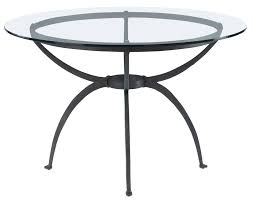 country dining table design with round flat polished glass table top and black wrought iron table black wrought iron table