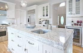 countertops granite marble: granite countertop color bianco romano on this kitchen island looks like carrara marble