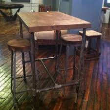 pipe base pub table with reclaimed wood top by steve garceau black iron pipe table