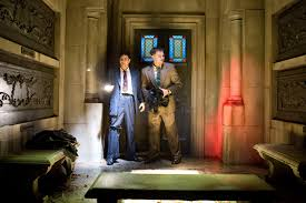 book vs film shutter island the motion pictures chuck and teddy explore the island and end up taking shelter from the stormy weather in a mausoleum image via lostinreviews com