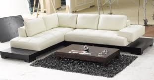 white leather low profile sectional chaise lounge sofa bed with black wooden base for modern living room with oak coffe table and black carpet tiles ideas chaise lounge sofa modern