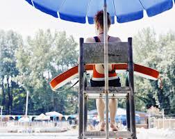 age appropriate summer jobs for younger teens teenage female lifeguard 14 16 watching pool rear view