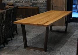 walnut cherry dining: live edge slab cherry dining table with mid century style open trapezoidal legs in walnut at