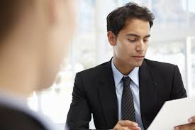 the best questions to ask in an interview on careers us news a man reading a resume