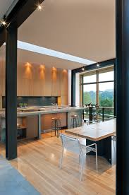 example of a minimalist galley eat in kitchen design in charlotte with flat panel cabinets and light wood cabinets archaic kitchen eat
