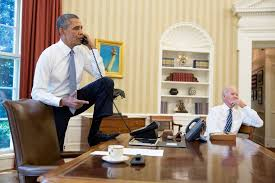 president barack obama talks on the phone in the oval office with speaker of the house barack obama oval office