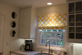 recessed lighting in white ceiling in modern kitchen in window treatment with muntins also wall cabinet above sink lighting