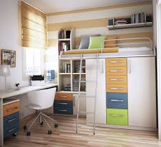 funky teenage bedroom furniture white wooden loft bed with storage and shelves combined with white wooden study table on the brown wooden flooring
