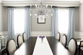 modern crystal funky cahndelier above flashing white table cloth on glosssy table with round backrested chairs beautiful funky dining room lights