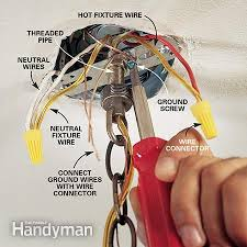 how to hang a ceiling light fixture the family handyman photo 8 connect the wires