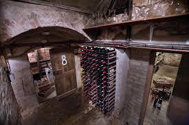 unusual underground cellar design ideas with wall mount wine rack and combine with barn wood door barrel wine cellar designs