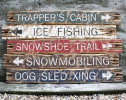 cabin decor lodge sled: trappers cabin decor ice fishing snowshoe snowmobiling dog sled wood log cabin lodge sign set