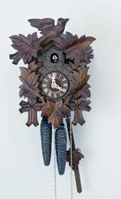 images about clocks vintage clocks black traditional cuckoo clock featuring carvings of bird and five maple leaves wooden cuckoo calls once on the half hour and on the full hour calls to count the