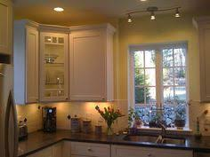 lighting above kitchen cabinets kitchen with small track lighting bar above sink above kitchen cabinet lighting