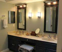 bathroom fascinating modern vanity lights light vertical black stained wooden frame wall mirrors under fixture combined bathroom lighting sconces