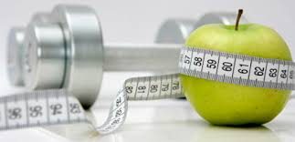 dumbbell and apple with a tape measure around it