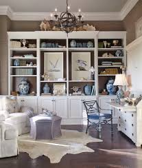 interior decorator dallas sunroom in home office beach with built in shelves animal skin rug animal hide rugs home office