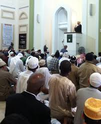 reporting on islam religionlink muslims listening to the sermon or khutba by imam suhaib webb at the islamic society of boston cultural center on the islamic holiday of eid al fitr