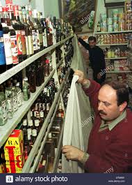 ismail a ian liquor store worker covers shelves of ismail a ian liquor store worker covers shelves of alcoholic drinks at a supermarket in amman 9 prohibits the of alcohol