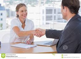 cheerful interviewer shaking hand of an interviewee stock photos cheerful interviewer shaking hand of an interviewee