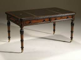 regency finished mahogany writing table with inlaid black leather top and brass mounts antique office table