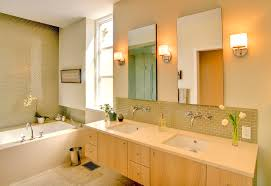 interior design of master bathrooms with rectangular shaped soaking tubs and floating beech wooden cabinet elegant vanity lights track fixture ideas bathroom bathroom vanity lighting ideas bathroom traditional