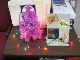 in my office last holiday seasonbr note the dwight schrute magnets christmas tree office desk