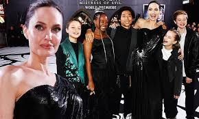Angelina Jolie stuns in black gown as she brings kids to Maleficent ...