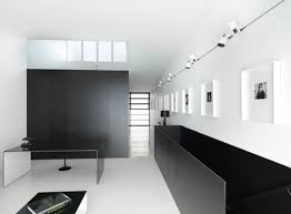 view in gallery minimalist interiors with a long gallery wall illuminated by track lighting art gallery track lighting