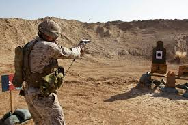 weapons training essay u s marine corps st sgt juan gallardo fires a mm pistol during a battle sight