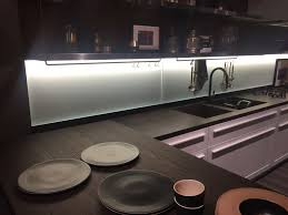 black countertop and pink cabinets with led under cabinet lighting ambiance under cabinet lighting