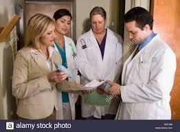 drug rep meets three doctors stock photo royalty image drug rep meets three doctors